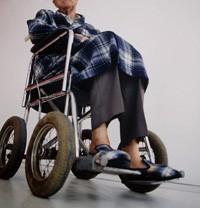 Elderly Man in Wheelchair --- Image by © Claire Artman/zefa/Corbis